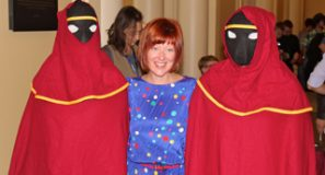 Robin Hunicke with cosplayers from her award-winning game, Journey.