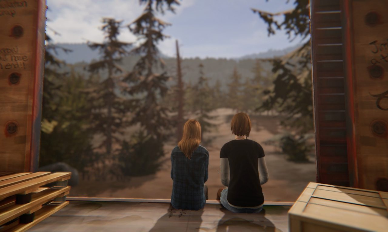 Rachel and Chloe sit in train car, looking at mountains and forest